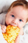small babyEating pizza