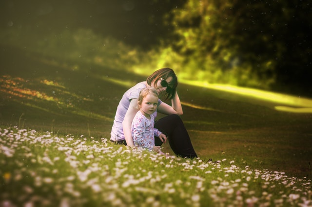 mother with kid in the fields